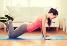 a woman practices doing push ups at home