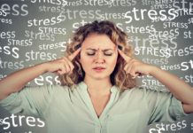 A woman pressing her fingers to her temples surrounded by the word stress