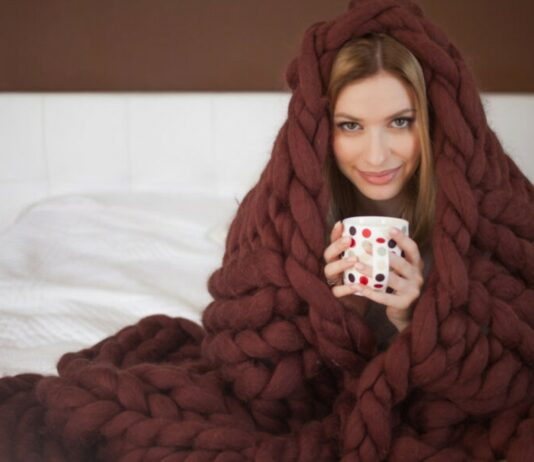 a woman wrapped in a blanket